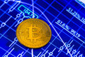Bitcoin and blue chart Royalty Free Stock Photo