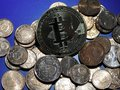 Bitcoin and Euro cents Royalty Free Stock Photo