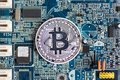 Bitcoin is placed on the motherboard, applicable to the business Royalty Free Stock Photo