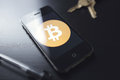 Bitcoin technology on smartphone the new digital cryptocurrency sweeping across the world being utilized a with misc items the Stock Images