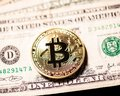 Bitcoin on outdated dollar bills Royalty Free Stock Photo