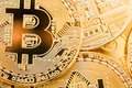 Bitcoins. Physical bit coins. Digital currency. Cryptocurrency. Golden coins with bitcoin. Close-up