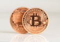 Bitcoins two front and backside bit coin btc the new virtual money Stock Photo