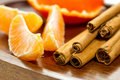 Bits of orange and cinnamon sticks Royalty Free Stock Photography