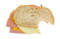 Bitten baloney sandwich with cheese Royalty Free Stock Photo