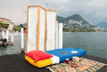 Bizarre bedroom on the lake shore view from the pier Stock Images
