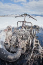 Bizarre burnt out snowmobile on yukon lake canada charred remains of in a winter motorsports mishap frozen laberge territory Royalty Free Stock Photo