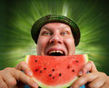 Bizarre man eating watermelon outdoors in summer Stock Image