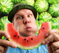 Bizarre man eating watermelon outdoors in summer Royalty Free Stock Photos