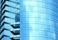 Blå glass modern skyskrapavägg Royaltyfria Foton