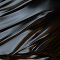 Black abstract background  cloth or liquid waves surface of wavy folds of silk texture Royalty Free Stock Photo