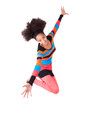 Black african american teenage girl with a afro haircut jumping of joy isolated on white background Stock Photography