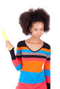 Black african american teenage girl combing her afro hair isolated on white background Stock Photography