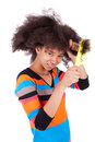 Black african american teenage girl combing her afro hair isolated on white background Royalty Free Stock Photos