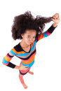 Black african american teenage girl holding her afro hair isolated on white background Royalty Free Stock Photo