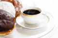 Black american coffee and donuts types of on a round plate Royalty Free Stock Images