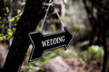 Black arrow with wedding sign