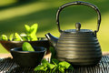 Black asian teapot with mint tea Royalty Free Stock Photo