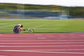 Black athlete racing wheelchair track Royalty Free Stock Photo