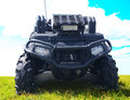 Black atv powerful frontally on grass Stock Image