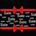 Black background with red ribbon and bow with the words sale sale inscription lettering vector illustration Stock Image
