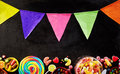 Black background with string of party flags on top Royalty Free Stock Photo