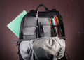 Black backpack with skolkimi items, back to school,