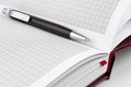 Black ballpoint pen lying in between the pages Royalty Free Stock Photography