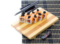 Black bamboo mat with sushi isolated on white background Royalty Free Stock Photo