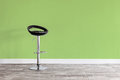 Black bar stool in front of wall. Royalty Free Stock Photo