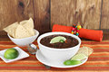 Black bean mexican soup with chips and lime. Royalty Free Stock Images