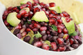 Black bean pomegranate and avocado relish a healthy or salsa with red onions beans cilantro served with corn chips Royalty Free Stock Photos
