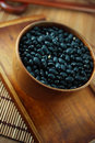 Black beans in bowl Stock Images