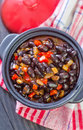 Black beans with chili on a table Royalty Free Stock Photos