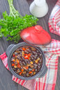 Black beans with chili on a table Royalty Free Stock Photography