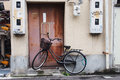Black bicycle park in front of an old rustic door Royalty Free Stock Photo