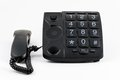 Black big button telephone a with the handset placed on the left hand side of the phone Royalty Free Stock Photos
