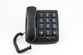 Black big button telephone a with the handset placed on the phone Stock Images
