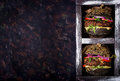 Black big sandwich - black hamburger with juicy beef burger, cheese, tomato, and red onion in box Royalty Free Stock Photo