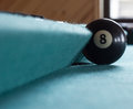 Black billiard ball. Royalty Free Stock Photos