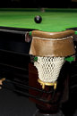 Black billiard ball in front of corner pocket on green baize table selective focus and shallow dof Royalty Free Stock Photography