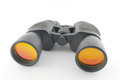 Black binoculars on the white background Royalty Free Stock Images