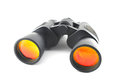 Black binoculars on the white background Stock Images