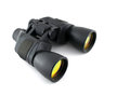 Black binoculars with yellow lens over white Stock Photography