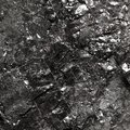 Black bituminous coal carbon nugget background hard closeup macro texture power and energy source Royalty Free Stock Photography