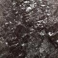 Black bituminous coal carbon nugget background hard closeup macro texture power and energy source Stock Image