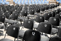 Black and blue plastic seats in an open air concert hall Royalty Free Stock Image