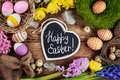 Black board with text - Happy Easter. Colorful