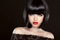 Black bob hair. Fashion model girl face. Brunette woman with red Royalty Free Stock Photo