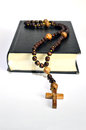 Black book of the rosary bible with wooden on white background Stock Photos